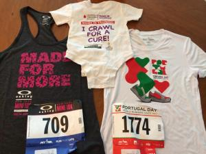 Shirts and bibs from this weekend's Oakley Women's Mini 10K and Portugal Day 5-miler as we ll as a onesie with Sacred Sounds Yoga's logo printed, 6/13/14